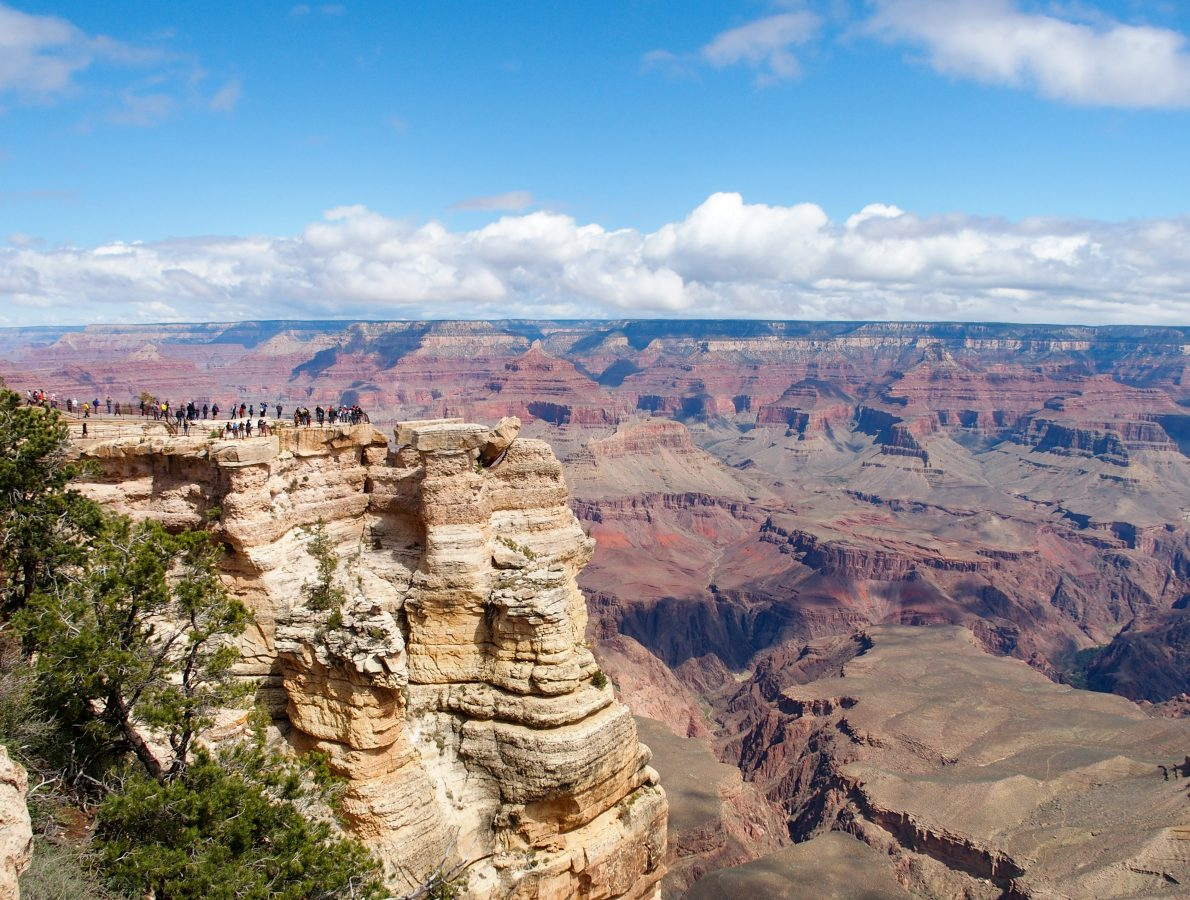 Tourists gathered at Mather Point (left) overlooking the Canyon.