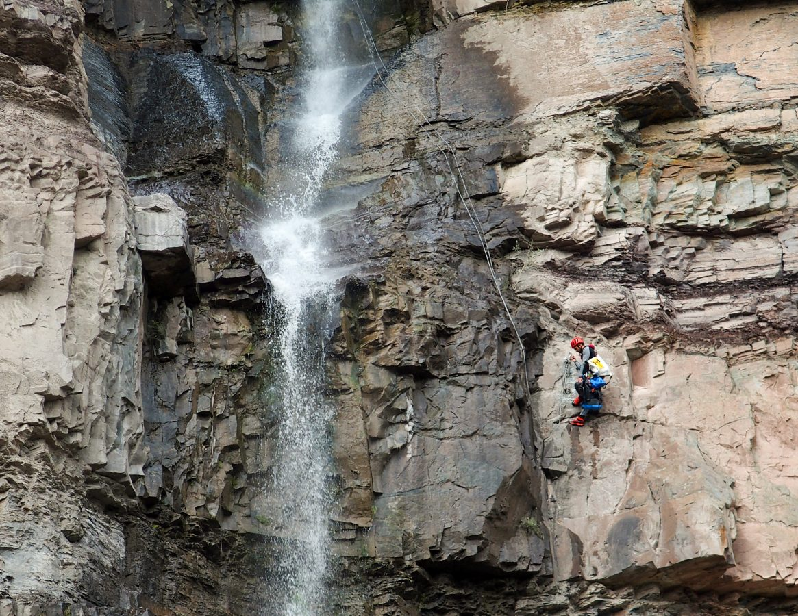Climber rapelling down Lower Cascade Falls